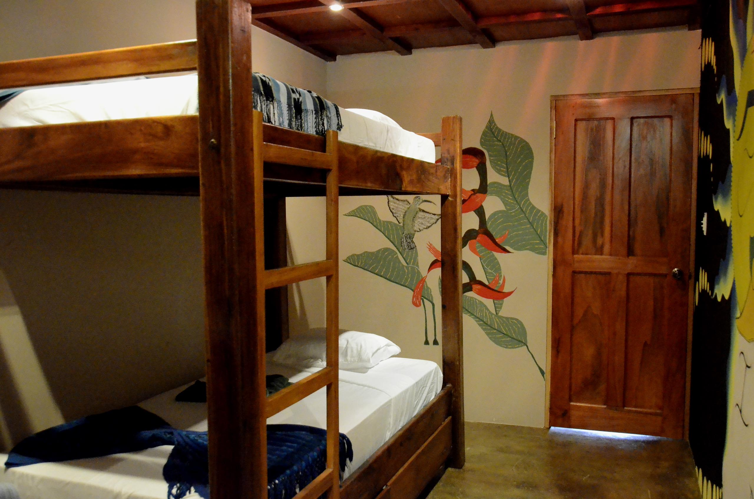 Casa Oro Group Nuestra-Casa-Eco-Guesthouse-San-Juan-Del-Sur-Nicaragua-Amor-Bunk-Room-Budget-Art-Comfortable-Wood-Furniture Nuestra Casa