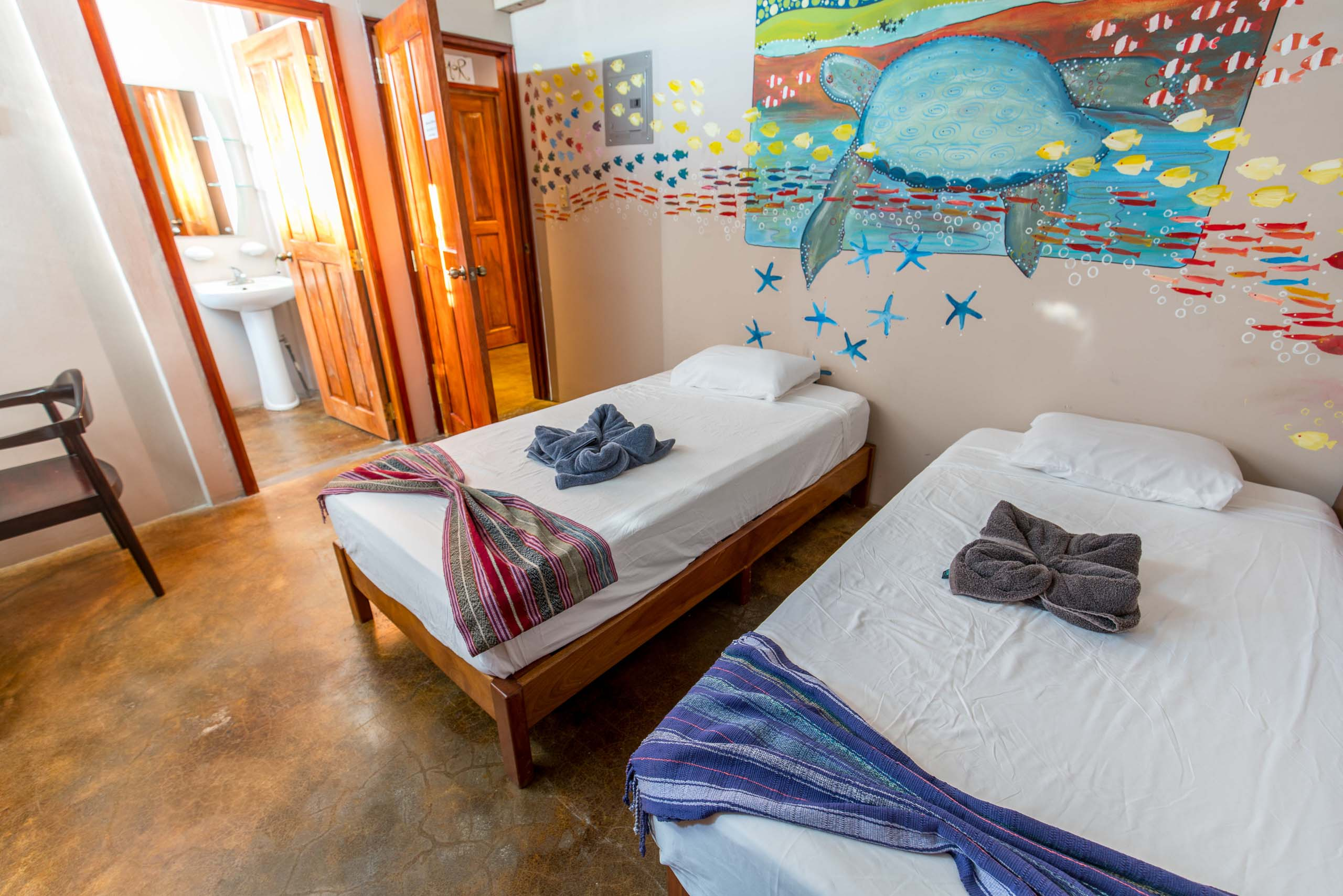 Casa Oro Group Nuestra-Casa-Eco-Guesthouse-San-Juan-Del-Sur-Nicaragua-Tortuga-King-Room-Twin-Beds-Art-Organic-Textile-Responsible-Travel Nuestra Casa