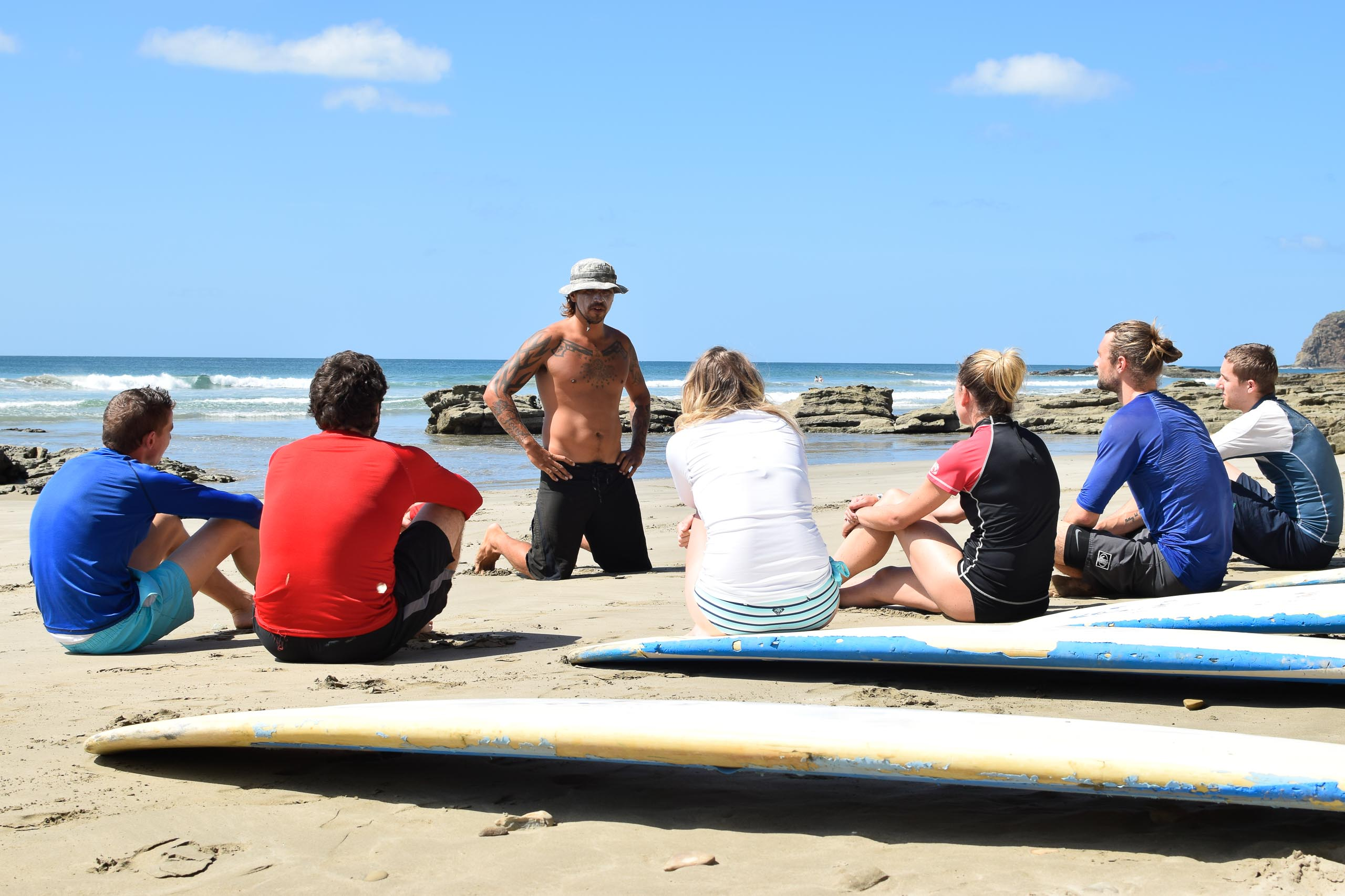 Casa Oro Group Surfing-Institution-Casa-Oro-Surf-San-Juan-del-Sur-Nicaragua-Adventure-Travel-Surf-School-Teaching-Student-Playa-Maderas Surf