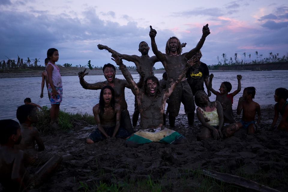 swimming in the river mud